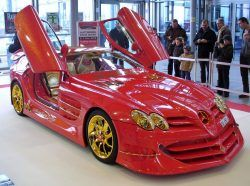 Bling Car: 2009 Mercedes SLR McLaren With 500 Rubies And 24Kt Gold that costs $4300000 to put together. #luxury #luxurylifestyle #luxuryliving