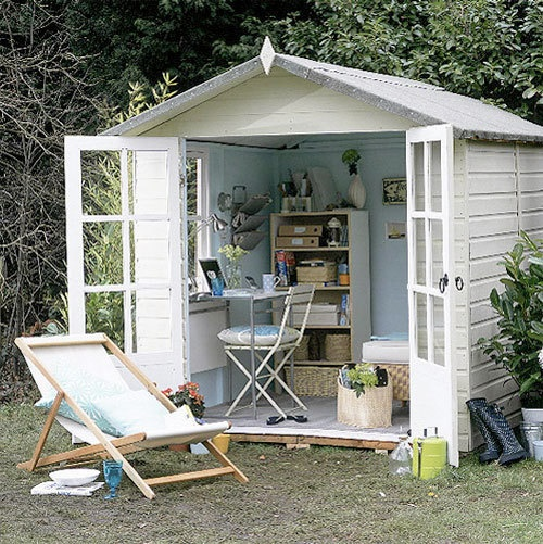 Converted shed to home office. I would decorate it completely different but I'm diggin' this idea!