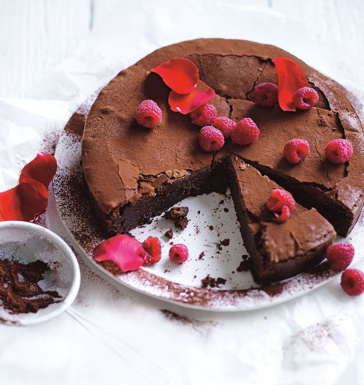 Crunchy on the outside and gooey on the inside, Simmone Logue's chocolate cake is best served with a drowning of double cream.