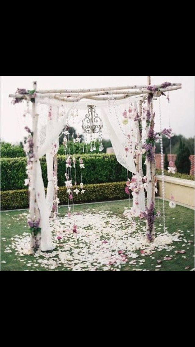 Country wedding arch. (Add garlands. Love the idea of scattered petals).