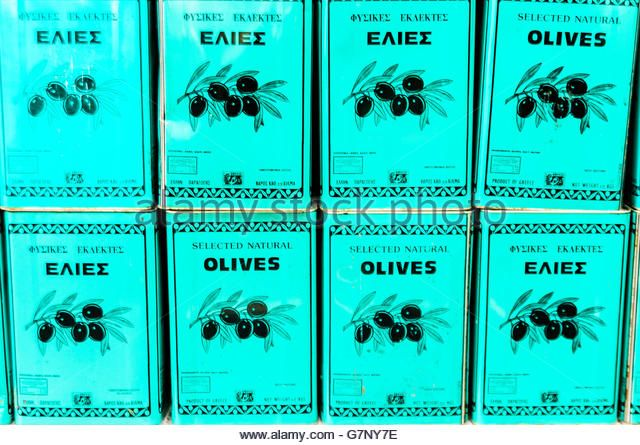 Large metal canisters of Greek olive oil. - Stock Image