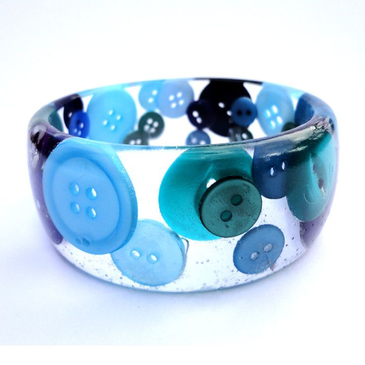 Buttons in resin bangle peacock colours blue green purple. via Etsy.