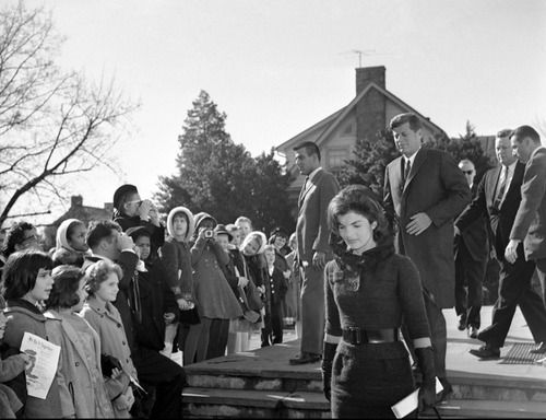 mrsjohnfkennedy:  President John F. Kennedy and First Lady Jacqueline Kennedy leave the Middleburg Community Centre in Middleburg, Feb. 4, 1962 after attending Roman Catholic services.  Look at jackie. Look at her. She looks so freaking gorgeous oh my god.