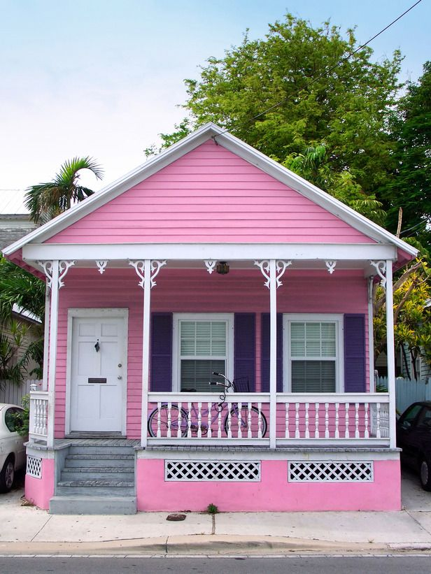 Playful Colors  Key West, or Conch, cottages feature fanciful elements like slim columns topped with decorative wooden details. Tropical and playful hues express a carefree attitude.