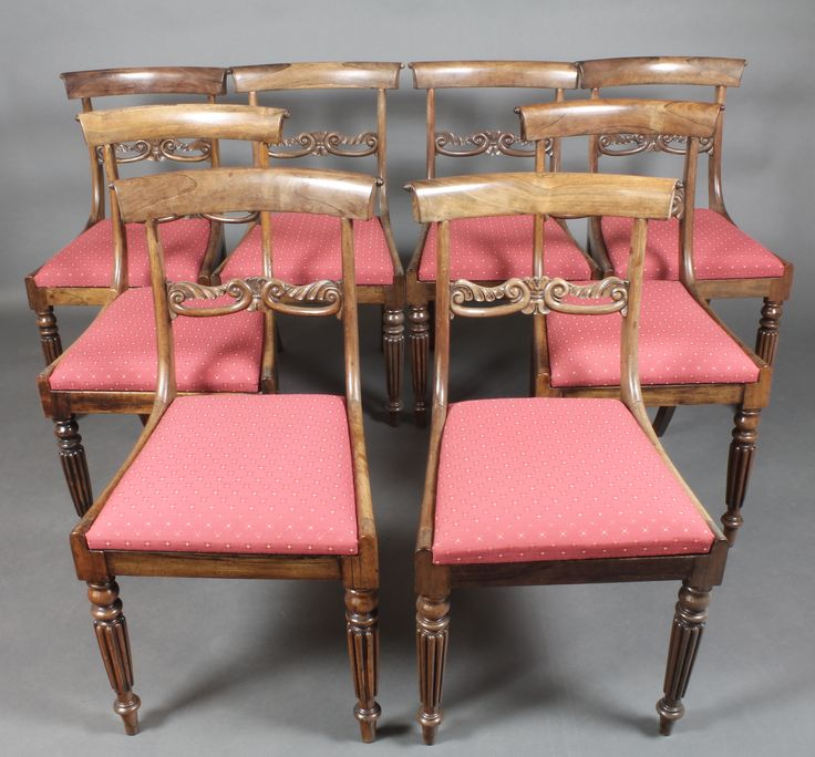 Lot 969, A set of 8 Georgian mahogany bar back dining chairs with carved mid rails, raised on turned and reeded supports, sold for £340.00