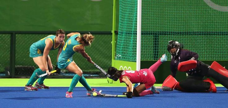 RIO DE JANEIRO, BRAZIL - AUGUST 13: Ayaka Nishimura of Japan is struck on the head by the stick of Peris Brooke during the Women's Pool B hockey match between Australia and Japan on Day 8 of the Rio 2016 Olympic Games at the Olympic Hockey Centre on August 13, 2016 in Rio de Janeiro, Brazil. (Photo by David Rogers/Getty Images) — in Rio de Janeiro, Brazil.