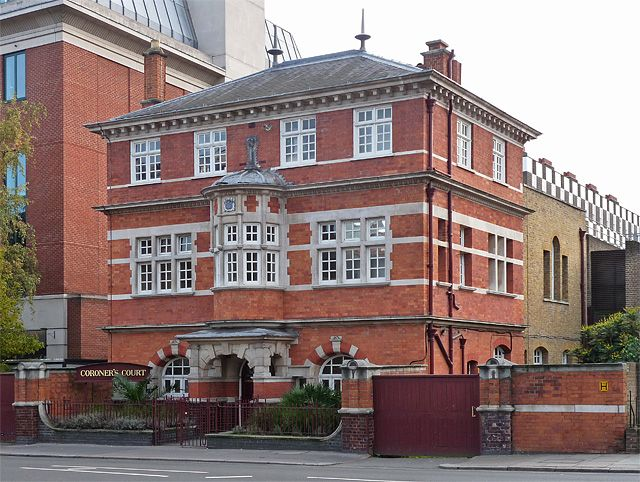 """Coroner's court, Horseferry Road. A lively affair by G.R.W. Wheeler in 1893. Red brick with generous Portland stone dressings and a small bow window over the porch. Grade II listed. The listing describes it as """"an early example of Arts and Crafts freely-handled neo-Georgian-Jacobean""""."""