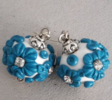 Check out this item in my Etsy shop https://www.etsy.com/listing/236966454/turquiose-and-white-flower-earrings