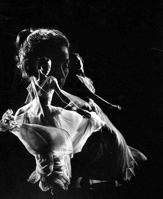 1946    Wearing a swirling chiffon evening dress by Adrian, photo by Gjon Mili.
