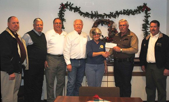 "The Electrical Connection, a partnership of the International Brotherhood of Electrical Workers (IBEW) Local One and the St. Louis Chapter, National Electrical Contractors Association (NECA), presents a $3,000 donation to the St. Francois County Sheriff's Department's ""Shop with a Cop"" program."
