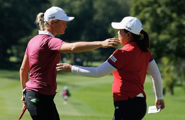 Suzann Pettersen of Norway (L) hugs Inbee Park of South Korea on the 18th green during the final round of the Lorena Ochoa Invitational Presented by Banamex at the Guadalajara Country Club on November 17, 2013 in Guadalajara, Mexico.