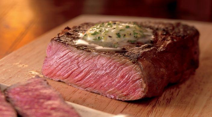 Rosemary-Marinated Rib Eye Steaks with Lemon-Pepper Butter