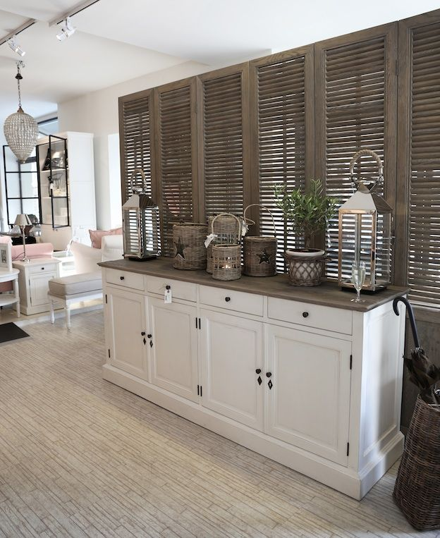 White with Neutrals. Love the drift-wood Color of the shutters and the top of the banquet.
