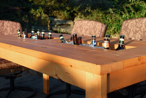 Step by step guide to make a patio table with built in beer / wine coolers with lids.