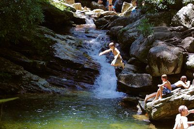 Skinny Dip Falls  Located on the Blue Ridge Parkway via a 1/2-mile hiking trail, Skinny Dip has beautiful waterfalls, a jumping off rock and several areas to soak and wade in very cool mountain waters. See our Skinny Dip Falls Guide.