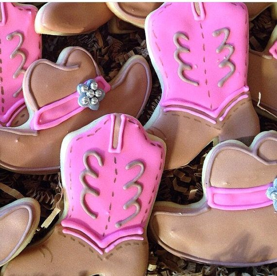 These fun cookies would complement any western birthday party bash! The cowboy boots are detailed with hand-painted stitching and the hat has a