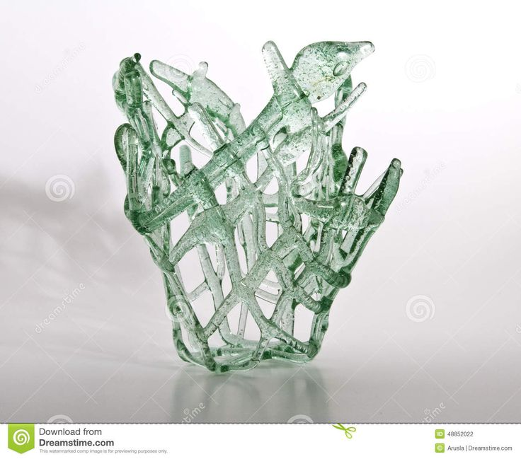 Exclusive hand made light green glass vase. For interiors and design room.