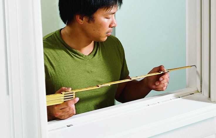 Measure horizontally and vertically between the window jambs in three places: top, middle, and bottom. Take the smallest of both sets of measurements and send them to the shutter company for custom shutters.