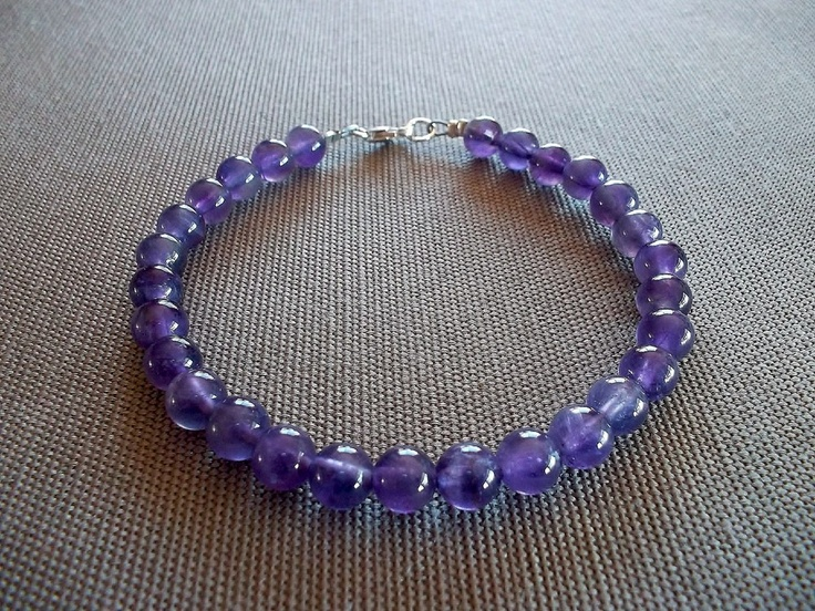 Handcrafted bracelet featuring 6mm round genuine amethyst beads. 8 inches in length with a sterling silver clasp.