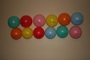 I love this idea for celebrating new year's eve with children! A balloon with a special activity inside for each hour.