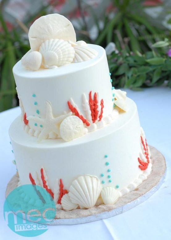 Gorgeous beach themed cake with coral and teal details