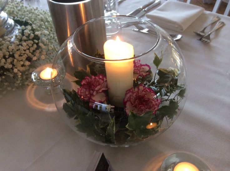 Fishbowl with carnations and ivy