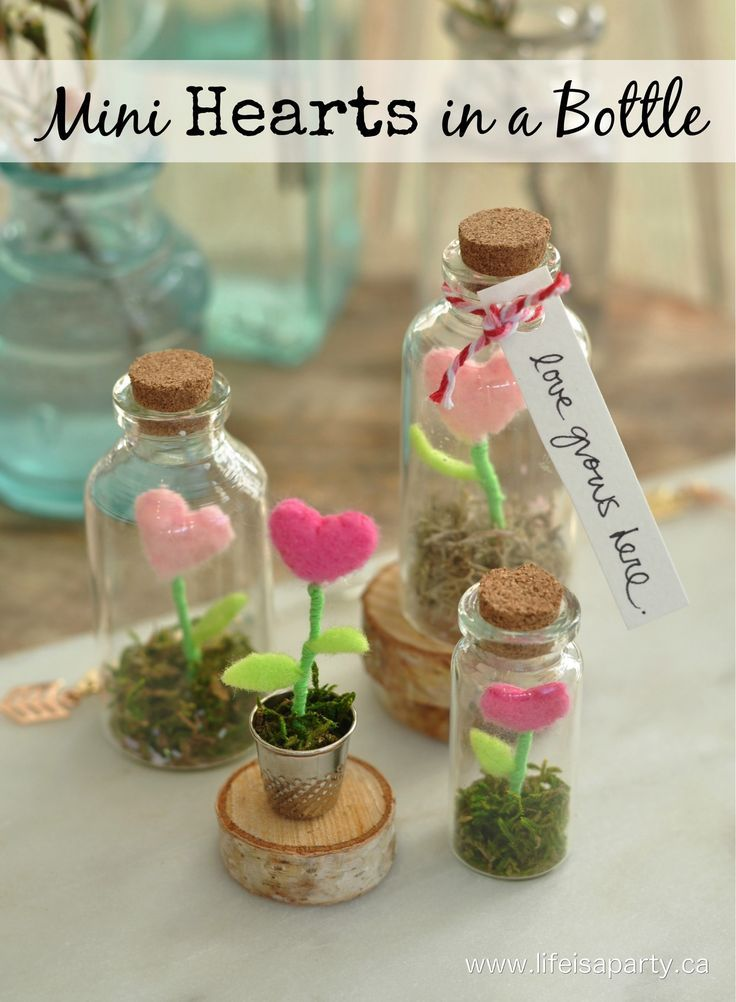 Mini Hearts in a Bottle:  Tiny felt heart flowers inside a glass jar create a magical terrarium garden.