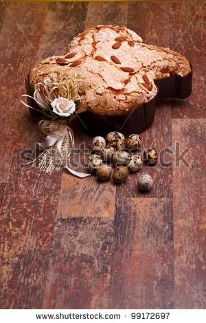 Stock photo available for sale at Shutterstock: Traditional Italian desserts for Easter - Easter dove and quail eggs, on wood table, portrait layout. by eZeePics Studio, via ShutterStock