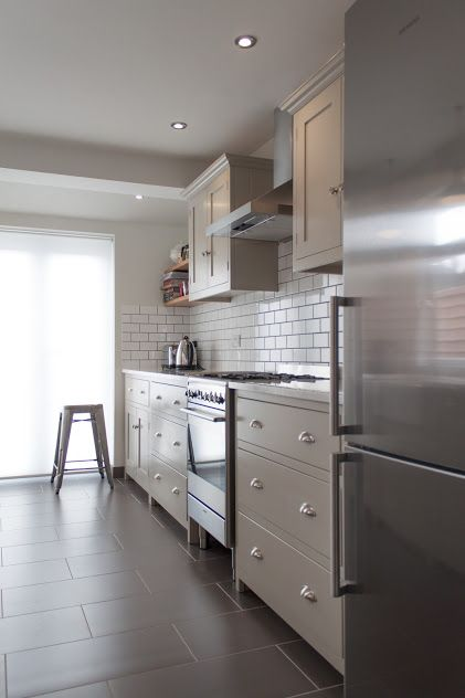 Omg! Love this grey kitchen with white metro tiles. Grey floor tiles and lovely handles on cabinet. This might just be the kitchen I've been looking to emulate!!! :))))