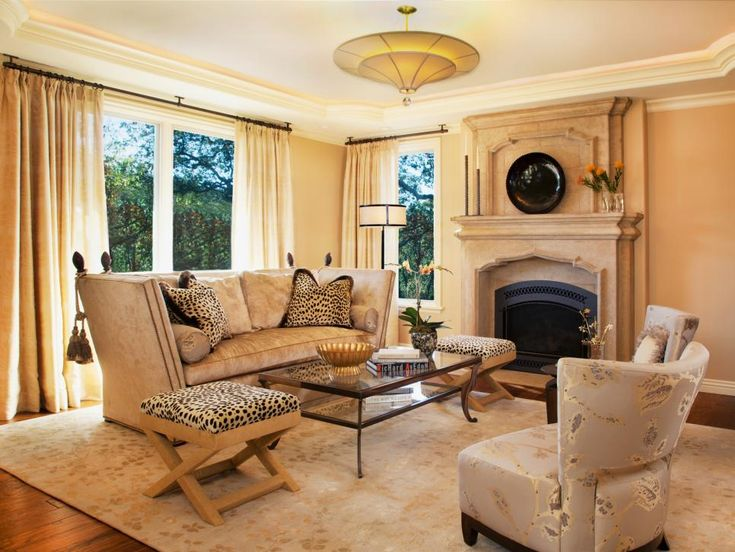 Cheetah Print Upholstery Adds A Cheeky Touch To This Formal Living Room.  The Furniture
