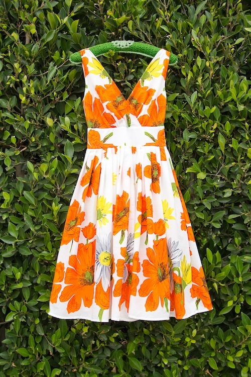 What a lovely summer sundress! via modcloth - what a cute way to photograph a vintage dress!