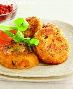 One of the most popular street foods, aloo tikki is an evergreen one too, loved by several generations of indians. Hot and crisp aloo tikkis are to be relished right off the tava, to warm your body and soul even on a cold, rainy day! here is how you can make wonderful aloo tikki in your own kitchen, with the right proportion of potatoes, peas, spices and garnishes. Share a joyous moment with your family, with plates of aloo tikki and hot masala chai.