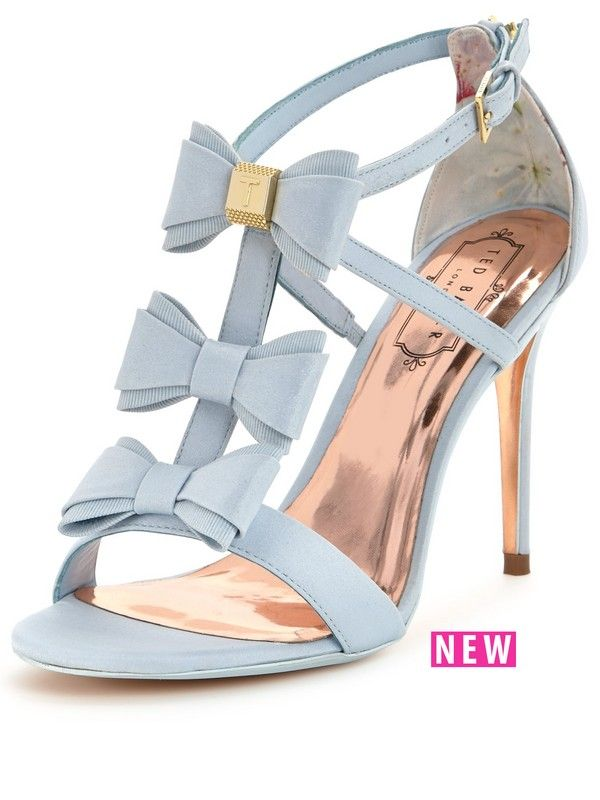 Ted Baker Appolni Bow Heeled Sandals Look to Ted Baker and these Appolni bow heeled sandals to style you out ready for the most special of occasions. Super sweet bows and a powder blue hue combine to create a gorgeously girly pair that earn polished points too with metallic detailing and a rose gold sole. For a little retro-inspirations, wear yours with a full midi dress, your trusty Ted Baker clutch and glossy waves in your hair. Lining: Leather/TextileMaterial: LeatherSole: Other Mate...