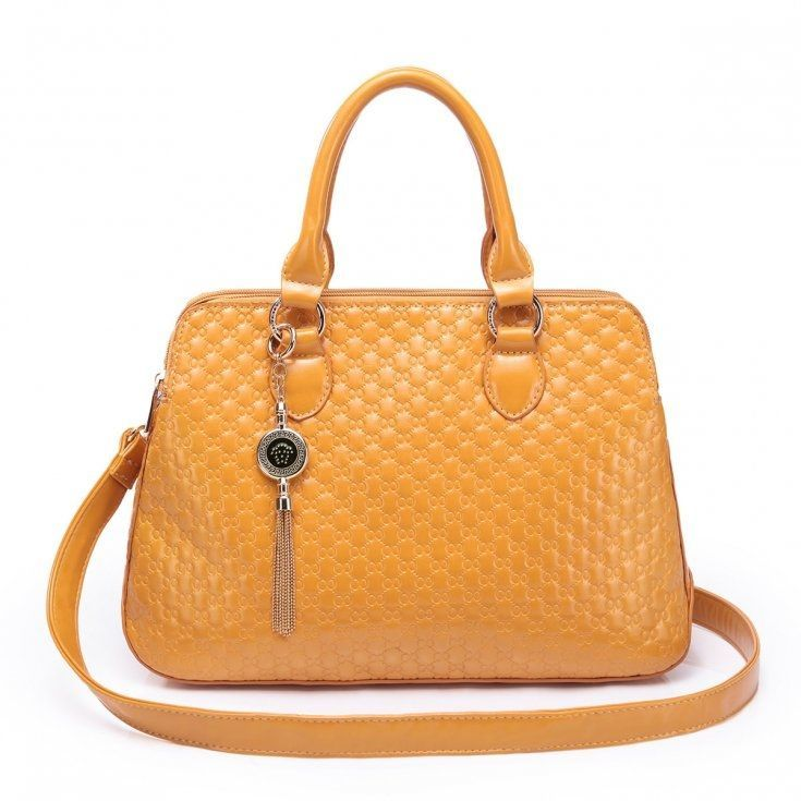 Kobiecy kuferek w kolorze złocistym