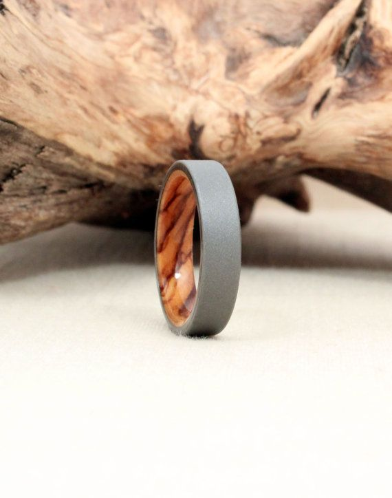 Size 7.75  Titanium Lined with Bethlehem by WedgewoodRings on Etsy, $215.00 Cool for Adam!!! If he'd ever wear a ring