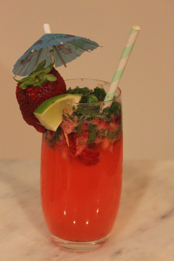 Sparkling Strawberry Mocktail Mojito Recipe made with Topo Chico Lime Flavored Mineral Water. Mint, Sugar in the Raw, Lime, and Strawberries