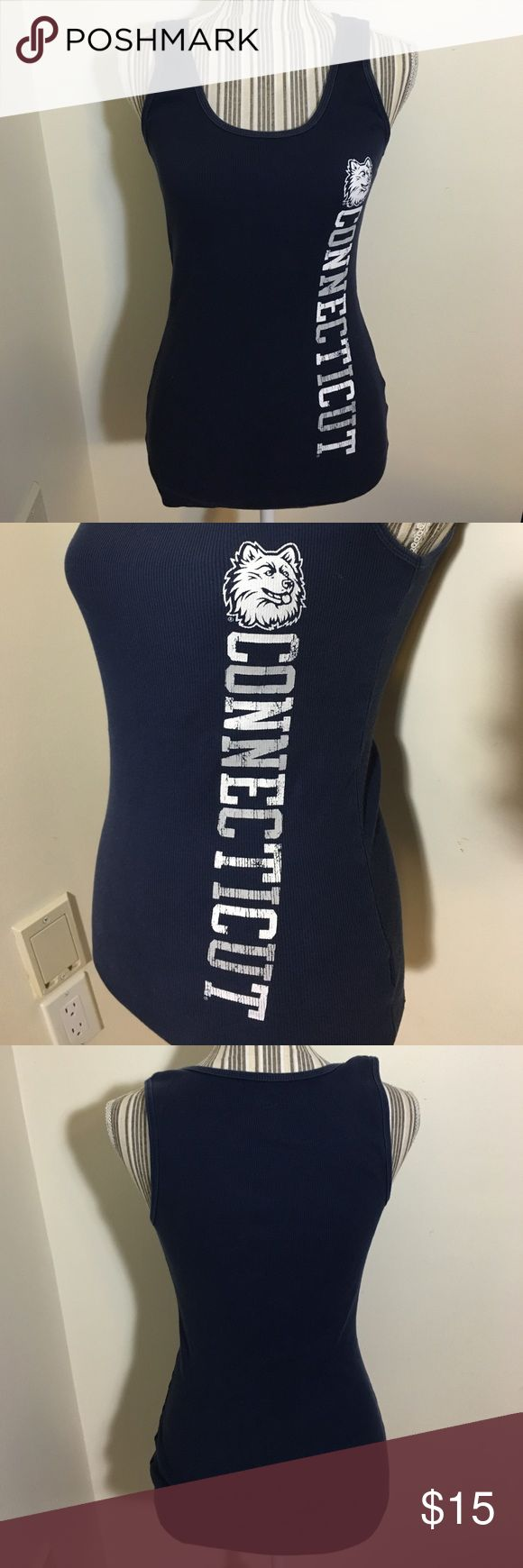 Fitted Navy Blue UCONN Huskies Connecticut Tank This tank top is fitted but stretchy. It's size XL and true to size, but also looks good on smaller sizes because of its fit. It was worn twice and just shows minor signs of wear but it's in excellent condition! The letters look cracked because that's how the style came. Super cute and perfect for showing your support for the University of Connecticut Soffe Tops Tank Tops