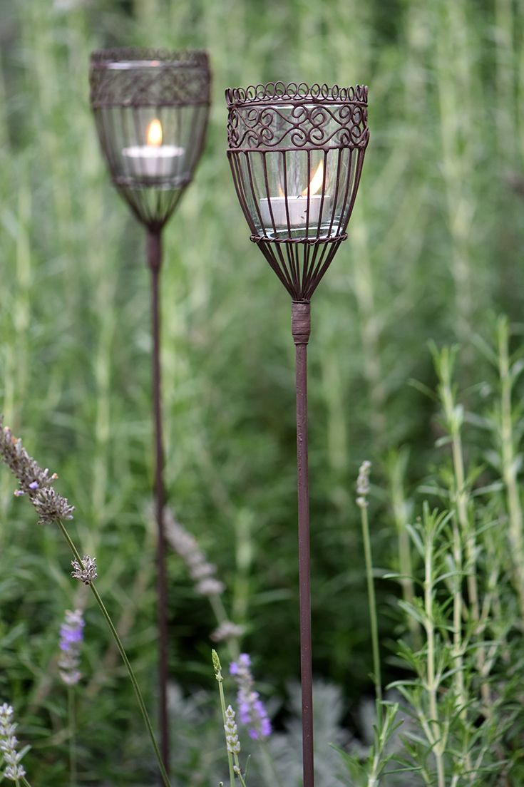 These elegant Kamla stake garden lanterns are a stunning way to light a path or add some light to a garden. The glass candle holders are also recycled.