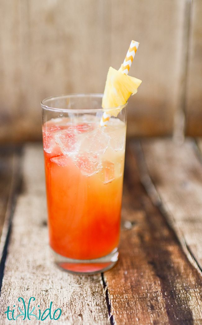 The perfect summer cocktail: the Piña Co-Lava.  Malibu coconut rum, pineapple juice, ginger ale, and a splash of grenadine syrup.  This is a drink that makes me love summer! #ad