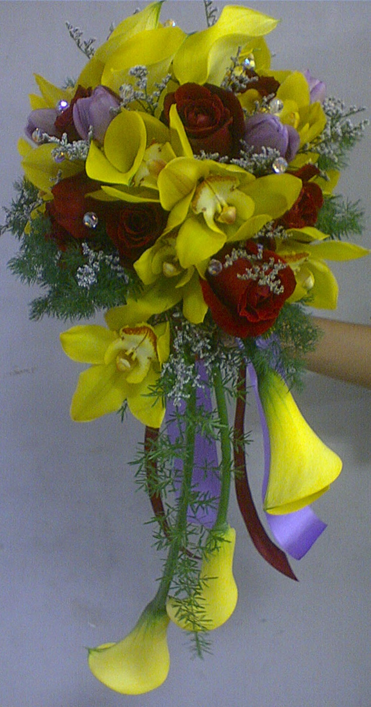 yellow calla with red roses