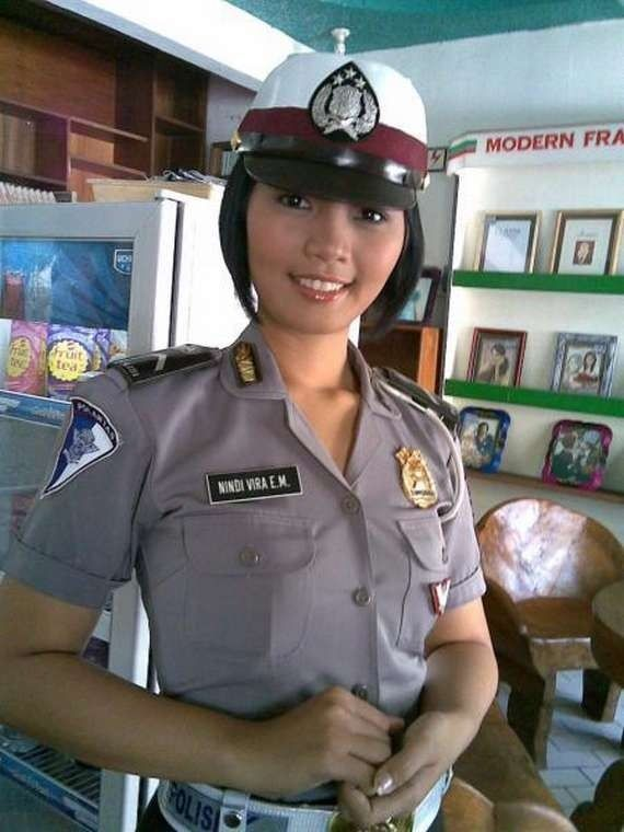 Indonesian police!  I'll bet this little cutie would surprise you with her FIERCENESS. Remember, never underestimate! Lol.