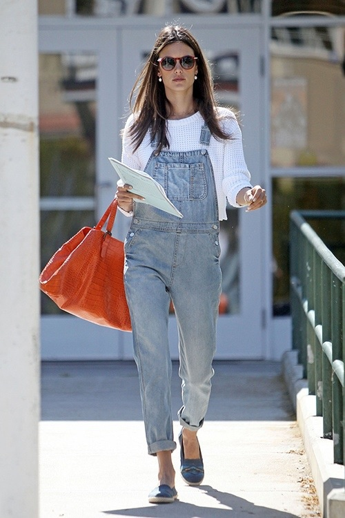 Alessandra Ambrosio rocks a pair of gray overalls and white sweater as she heads out of a Los Angeles school.