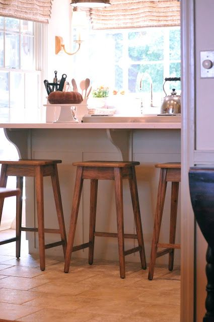 2 Wood Stools With Rectangular Seats At Kitchen Island