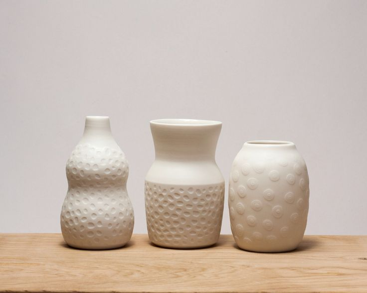 Small porcelain vases. Just white. Handmade on my potterswheel.