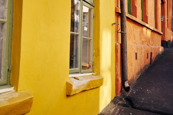 Colorful yellow and orange buildings with sunlight