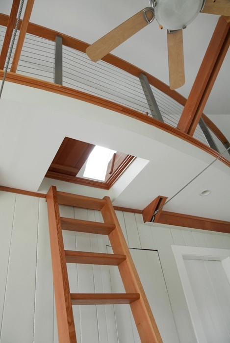 ship inspired ladder and hatch leads to a loft built by howell custom building group