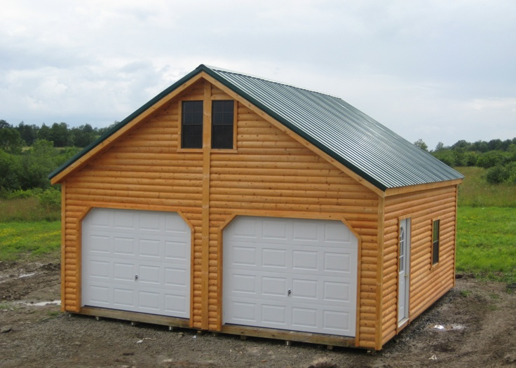 Log siding on this woodtex garage garages woodtex for Cheap house siding
