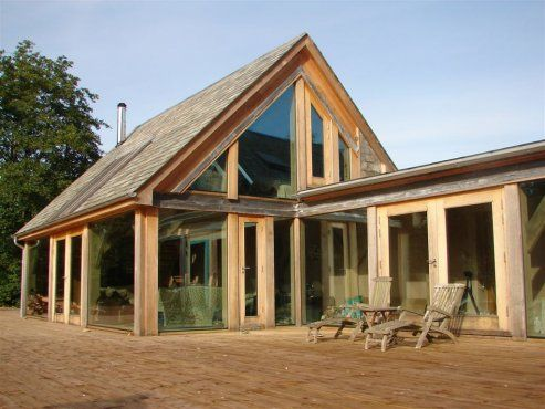 .Stone barn conversion with glazed oak addition/Roderick James Architects