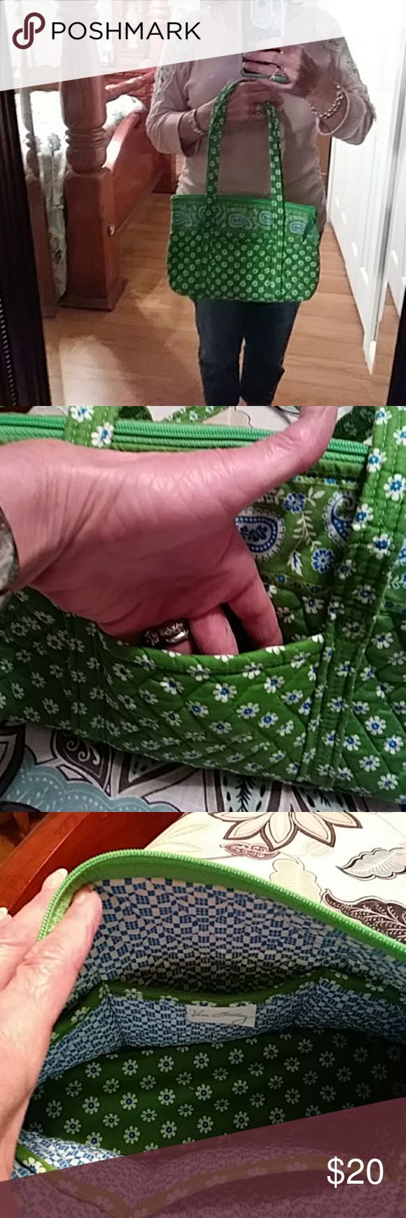 Nwot Vera Bradley purse Green with blue Paisley's and blue and white flowers. Never been used. Vera Bradley Bags Hobos