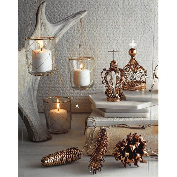 Home & Garden > Decor > Home Fragrance Accessories > Candle Holders. Radiant golden tones in an eclectic mix of forms are splendidly festive. Clear glass votive holders are encased in delicate brass mesh and meant to be grouped when hanging.